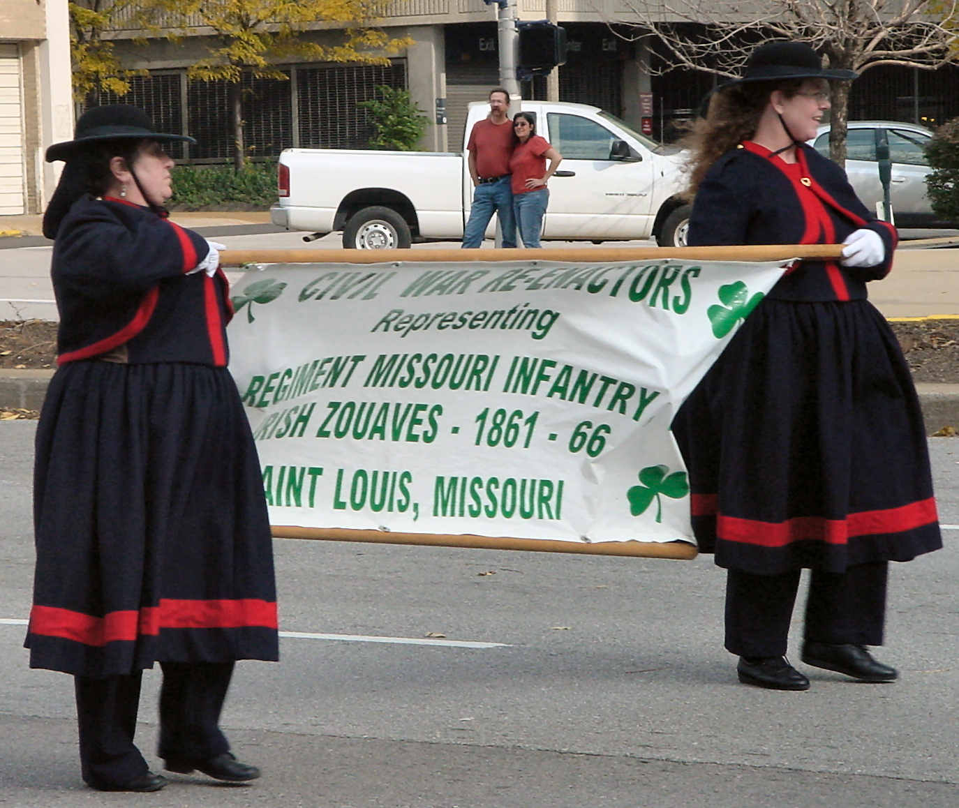 Women carrying banner in parade